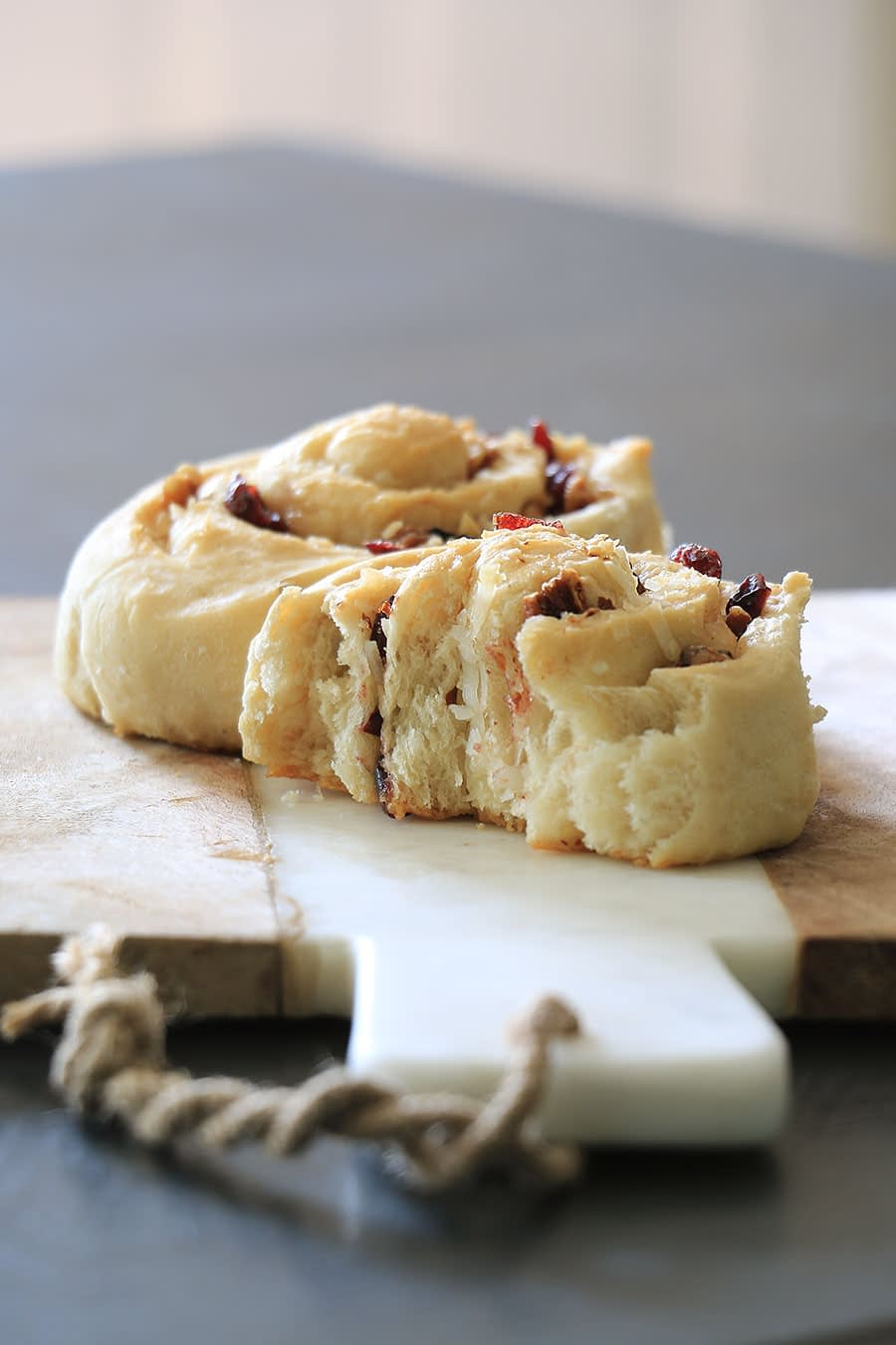 breakfast rolls with coconut flakes, cranberries, and nuts